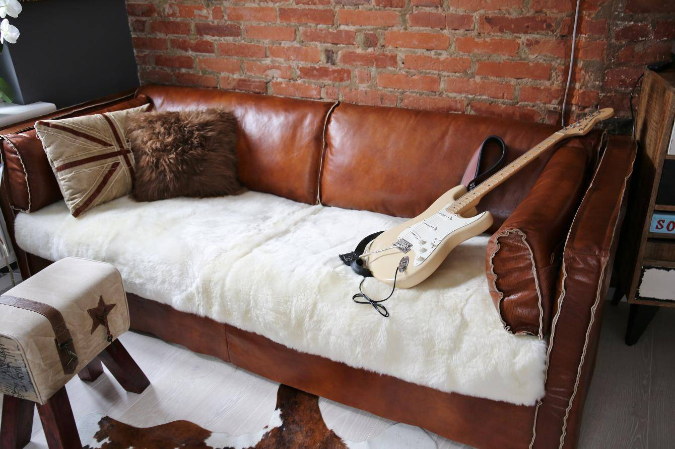 Hochwertige lammfelldecke online kaufen bei der fellmann for Couch auflage
